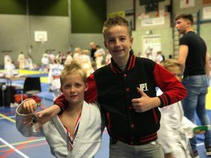 Tias Fikkert (zilver) met coach Bjorn Linde